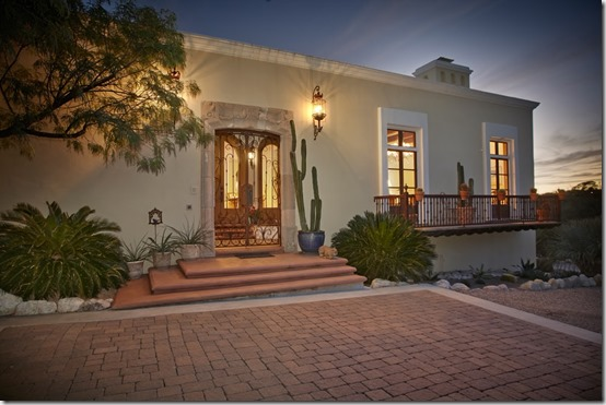It is perfectly sited on a hilltop lot in the old foothills to offer lush desert surroundings privacy and enchanting city sunset views